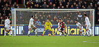 Lukasz Fabianski of Swansea (C) prepares for a shot by Matt Ritchie of Bournemouth during the Barclays Premier League match between Swansea City and Bournemouth at the Liberty Stadium, Swansea on November 21 2015