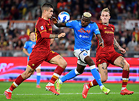 Calcio, Serie A: AS Roma vs SSC Napoli, Olympic stadium, October 24, 2021.<br /> Napoli's Victor Osimhen (C) in action with Roma's Gianluca Mancini (L) and Rick Karsdorp (R) during the Italian Serie A football match between Roma and Napoli at Rome's Olympic stadium, on , October 24, 2021. <br /> UPDATE IMAGES PRESS/Isabella Bonotto