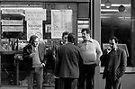 London 1970s men hanging around in front of corner shop newsagents and general store. Strutton Ground Street Victoria  1976 UK