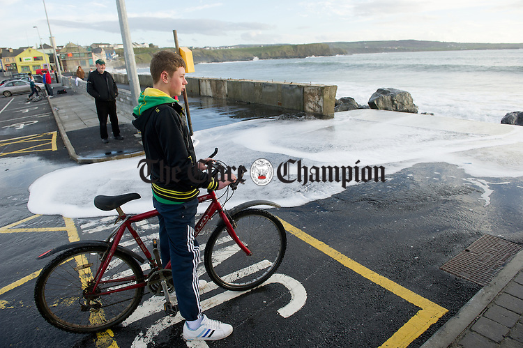 The sea spills over the promenade during high tide at Lahinch. Photograph by John Kelly.