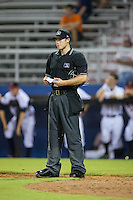 Home plate umpire Zach Neff checks his lineup card as the Burlington Royals make a pitching change during the game against the Danville Braves at American Legion Post 325 Field on August 16, 2016 in Danville, Virginia.  The game was suspended due to a power outage with the Royals leading the Braves 4-1.  (Brian Westerholt/Four Seam Images)