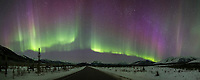 Panorama of the northern lights and dalton highway, Brooks Range mountains in Alaska's Arctic.