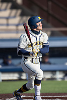 Michigan Wolverines second baseman Riley Bertram (12) follows through on his swing during the NCAA baseball game against the Illinois Fighting Illini at Fisher Stadium on March 19, 2021 in Ann Arbor, Michigan. Illinois won the game 7-4. (Andrew Woolley/Four Seam Images)