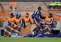 Thierry Henry of France pats team-mate Sidney Govou on the back as he sits on the bench