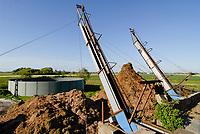 GERMANY, Pellworm, milk cow farm, slurry tank and manure