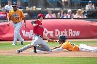 Akron RubberDucks outfielder Will Benson (29) slides into third as Erie Seawolves third baseman Andre Lipcius (18) misses the ball on June 27, 2021 at Canal Park in Akron, Ohio. (Andrew Woolley/Four Seam Images)