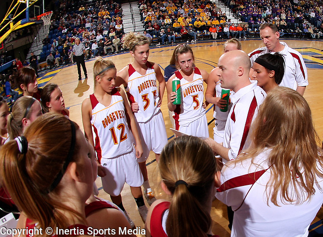 BROOKINGS, SD - March 12, 2009 : Roosevelt Head Coach Chris Clark rallies his team in the second half in their State Girls AA Tournament game against the Watertown Arrows at Frost Arena in Brookings on Thursday. (Photo By Stephen Brua/ Inertia)