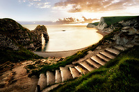 Sunset at Durdle Door with pathway. Dorset, Jurassic Coast, England