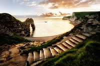 Sunset at Durdle Door with pathway. Dorset, Jurassic Coast, England