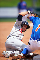 Brevard County Manatees first baseman Dustin DeMuth (4) slides into third during a game against the St. Lucie Mets on April 17, 2016 at Tradition Field in Port St. Lucie, Florida.  Brevard County defeated St. Lucie 13-0.  (Mike Janes/Four Seam Images)