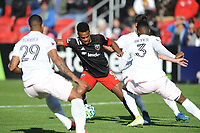 WASHINGTON, DC - MARCH 07: Ola Kamara #9 of D.C. United battles the ball with Andres Reyes #3 of Inter Miami CF during a game between Inter Miami CF and D.C. United at Audi Field on March 07, 2020 in Washington, DC.
