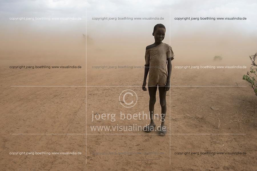 ETHIOPIA, Southern Nations, Lower Omo valley, Kangaten, village Kakuta, Nyangatom tribe, boy in sandstorm / AETHIOPIEN, Omo Tal, Kangaten, Dorf Kakuta, Nyangatom Hirtenvolk, Junge Lonok im Sandsturm