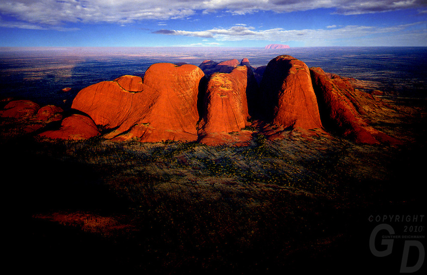 Images from the Book Journey Through Color and Time, Aerial over the Olgas in the background Ayers Rock called Uluru, Northern Territory, Australia at sunset