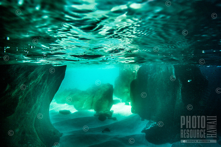 An underwater view from a sea cave looking out at Waimea Bay, O'ahu.