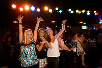 Customers cheer on the musicians at the Howl at the Moon nightclub in Charlotte, NC. Photos taken with permission of bar management.