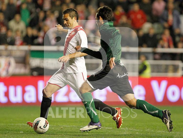 Rayo Vallecano's Emiliano Daniel Armenteros (l) and Betis' Jose Antonio Dorado during La Liga match.March 17,2012. (ALTERPHOTOS/Acero)