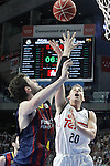 Real Madrid's Jaycee Carroll (r) and FC Barcelona's Ante Tomic during Liga Endesa ACB 2nd Final Match.June 21,2015. (ALTERPHOTOS/Acero)