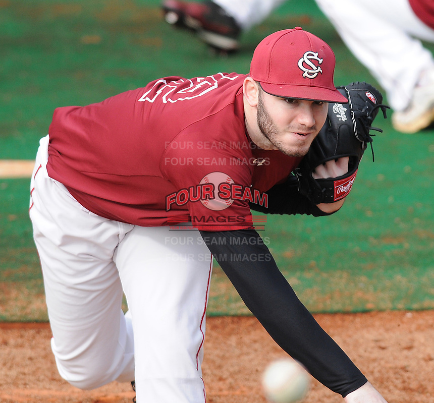 Righthanded pitcher Matt Price (22) of the University of South Carolina Gamecocks during a workout on January 20, 2012, at Carolina Stadium in Columbia, South Carolina. Price has been named a first team 2012 Preseason All-American by the National Collegiate Baseball Writers Association. (Tom Priddy/Four Seam Images)