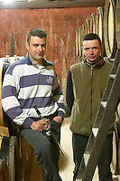 Frédéric Pourtalié, Domaine de Montcalmes, left, and his cousin Vincent Guizard of dom Dom Saint Sylvestre, in Puechabon. Terrasses de Larzac. Languedoc. Barrel cellar. Owner winemaker. France. Europe.