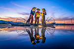 Fishermen are illuminated by their lanterns as they start their day by Zay Yar Lin