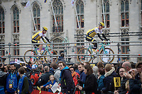 Sep Vanmarcke (BEL/LottoNL-Jumbo) riding above the crowd as he makes his way towards the start podium on the Bruges Market Square, followed by teammate Bram Tankink (NLD/LottoNL-Jumbo)<br /> <br /> 100th Ronde van Vlaanderen 2016