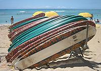 Surfboard rentals sit on Waikiki Beach, Honolulu, Hawaii.