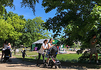 High Wycombe, England. 19 May 2020<br /> .<br /> People social distancing in a park in High Wycombe enjoy exercise during the current lockdown with new guidelines issued by the government at The Rye, Park, Bucks, England on 19 May 2020. Photo by Andy Rowland.