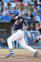 Asheville Tourists catcher Michael Ramirez #13 swings at a pitch during a game against the West Virginia Power at McCormick Field on April 13, 2013 in Asheville, North Carolina. The Power won the game 14-9. (Tony Farlow/Four Seam Images).