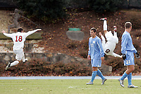 SMU's Chase Wileman (18) leaps in to celebrate with Bruno Guarda (8), who completes his tumbling run following his goal at 39:09 of the first half.  Southern Methodist University defeated the University of North Carolina 3-2 in double overtime at Fetzer Field in Chapel Hill, North Carolina, Saturday, December 3, 2005.