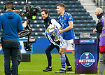 Livingston v St Johnstone …28.02.21   Hampden   BetFred Cup Final<br />No presentation ceremony as captain Jason Kerr collects the trophy after winning the BETFRED Cup<br />Picture by Graeme Hart.<br />Copyright Perthshire Picture Agency<br />Tel: 01738 623350  Mobile: 07990 594431