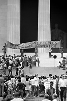 1970 Jun. 19.<br /> Black Panther Convention, Lincoln Memorial, Washington, D.C., 1970 <br /> Photograph showing people gathered on the steps of the Lincoln Memorial with a banner for the Revolutionary People's Constitutional Convention.