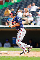 Phil Gosselin (8) of the Gwinnett Braves follows through on his swing against the Charlotte Knights at Knights Stadium on July 28, 2013 in Fort Mill, South Carolina.  The Knights defeated the Braves 6-1.  (Brian Westerholt/Four Seam Images)