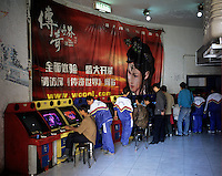 School children play video games in an internet cafe of Urumqi, Xinjiang, China. .30 Sep 2005