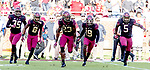 Florida State defensive back Hamsah Nasirildeen (23) and teammates Leonard Warner lll (35) Stanford Samuels lll (8) A.J. Westbrook (19) and Dontavious Jackson (5) celebrate Nasirildeen's interception of Boston College in the first half of an NCAA college football game in Tallahassee, Fla., Saturday, Nov. 17, 2018. (AP Photo/Mark Wallheiser)