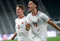 WASHINGTON, DC - SEPTEMBER 6: Maryland midfielder Brayon Padilla (70) with Maryland forward Hunter George (7) after scoring the winning goal during a game between University of Virginia and University of Maryland at Audi Field on September 6, 2021 in Washington, DC.