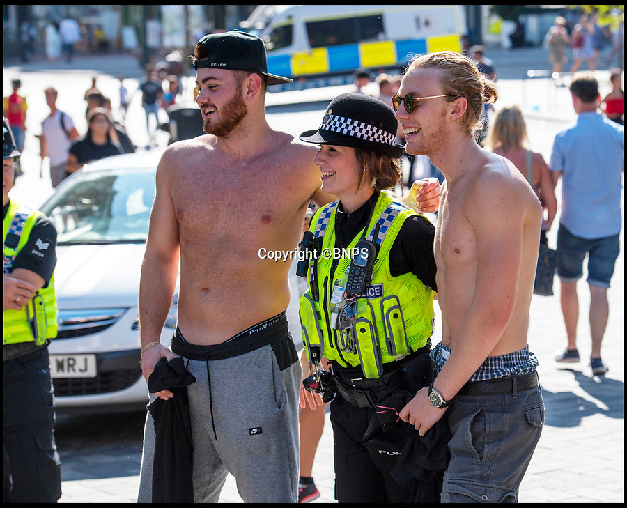 BNPS.co.uk (01202 558833)<br /> Pic: LeeMcLean/BNPS<br /> <br /> Police joined in.......<br /> <br /> Sizzling Saturday in Bournemouth as football fever gripped the seaside resort, with fans havng to resort to peering in windows as all the bars were full.