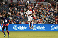 KANSAS CITY, KS - JULY 15: Walker Zimmerman #5 of the United States and Samuel Camille #18 of Martinique battle for a ball during a game between Martinique and USMNT at Children's Mercy Park on July 15, 2021 in Kansas City, Kansas.