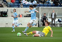 Chicago midfielder Karen Carney (14) leaps to avoid the slide tackle by  Philadelphia midfielder Jen Buczkowski (4).  The Philadelphia Independence defeated the Chicago Red Stars 1-0 at Toyota Park in Bridgeview, IL on May 15, 2010.