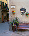 Tuscany, Italy:  Street scene with an osteria's bench on the Piazza di Spagna in the hilltown of Pienza