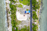 An aerial view of a small construction site in the Tuvaluan capital of Funafuti. Located in the South West Pacific Ocean, Tuvalu is the world's 4th smallest country and is one of the most vulnerable to climate change impacts including sea level rise, drought and extreme weather events. Tuvalu - March, 2019.