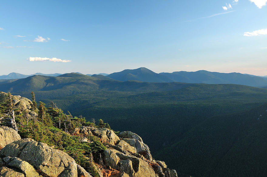 A distant view out to Mt. Carrigain awaits from a rocky outcrop.