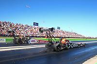 Sept. 22, 2013; Ennis, TX, USA: NHRA top fuel dragster driver Spencer Massey (right) races alongside Doug Kalitta during the Fall Nationals at the Texas Motorplex. Mandatory Credit: Mark J. Rebilas-