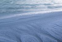 Salt crystals ring the shores of Laguna Amarga.