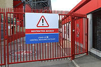 A sign on the gates outside the ground at Charlton Athletic show Covid-19 measures are in place and restricted access into the car park during Charlton Athletic vs Reading, Sky Bet EFL Championship Football at The Valley on 11th July 2020