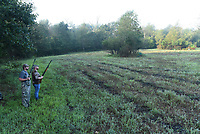 Matt Hughes (left) of Tontitown and Jake Taylor of Gravette scan the sky on Sept. 5 2020 during opening morning of Arkansas' dove hunting season. They hunted at one of the Arkansas Game and Fish Commission public dove hunting fields east of Siloam Springs. Hunting at the fields is free and no permit is required. State hunting license regulations apply.<br />