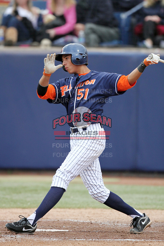 Greg Velazquez #51 of the Cal. St. Fullerton Titans bats against the Cal. St. Long Beach 49'ers at Goodwin Field in Fullerton,California on May 14, 2011. Photo by Larry Goren/Four Seam Images