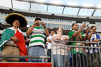 Santos Laguna fans take pictures during warmups. The New England Revolution defeated Santos Laguna 1-0 during a Group B match of the 2008 North American SuperLiga at Gillette Stadium in Foxborough, Massachusetts, on July 13, 2008.