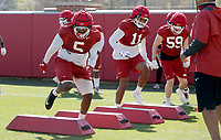 Dorian Gerald (5) participates in an agility drill with during the University of Arkansas Razorback Spring football practice Thursday, April 1, 2021, at the University practice field on the campus in Fayetteville. Check out nwaonline.com/210402Daily/ and nwadg.com/photos for a photo gallery.<br /> (NWA Democrat-Gazette/David Gottschalk)