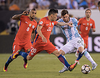 Action photo during the match Argentina vs Chile, Corresponding to Great Final of the America Centenary Cup 2016 at Metlife Stadium, East Rutherford, New Jersey.<br /> <br /> <br /> Foto de accion durante el partido Argentina vs Chile, correspondiente a la Gran Final de la Copa America Centenario 2016 en el  Metlife Stadium, East Rutherford, Nueva Jersey, en la foto: (i-d) Arturo Vidal, Charles Aranguiz de Chile y Lionel Messi de Argentina<br /> <br /> <br /> 26/06/2016/MEXSPORT/David Leah.