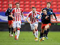 20th February 2021; Bet365 Stadium, Stoke, Staffordshire, England; English Football League Championship Football, Stoke City versus Luton Town; Harry Cornick of Luton Town and Rhys Norringrton-Davies of Stoke City chase a loose ball